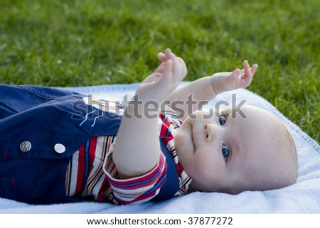Beautiful baby lies on a coverlet - stock photo