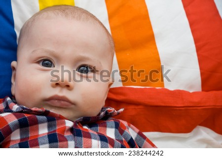 beautiful baby lying in a crib - stock photo