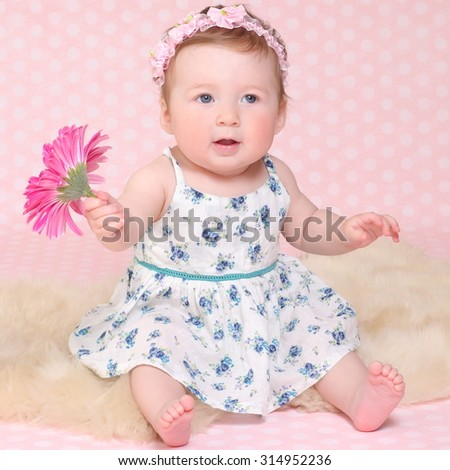 beautiful baby on a pink background. happy adorable child - stock photo