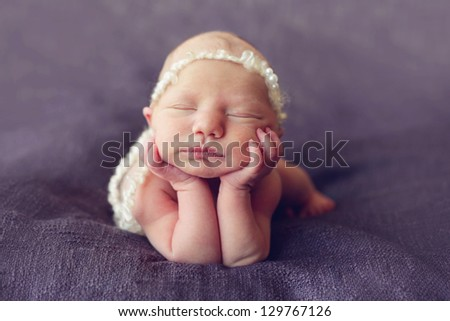 Beautiful baby on its elbows - stock photo