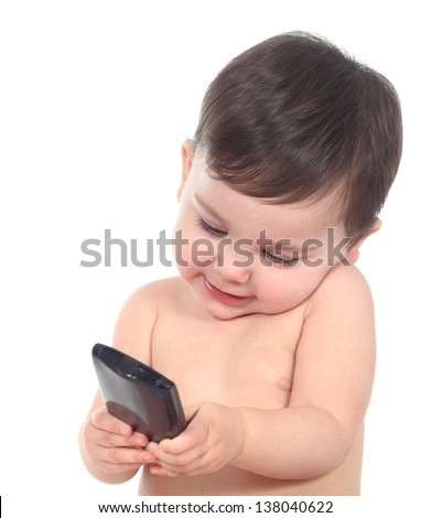 Beautiful baby playing and touching a smart phone isolated on a white background