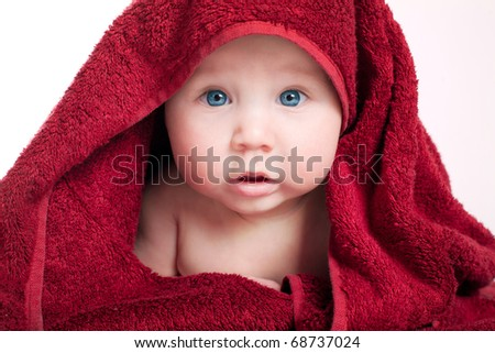 beautiful baby portrait in red towel - stock photo