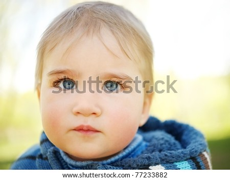 Beautiful baby portrait outdoors - stock photo