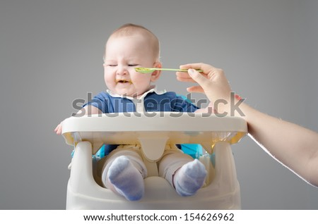 Beautiful baby refuses to eat. The most adorable boy in the world. High definition image. - stock photo