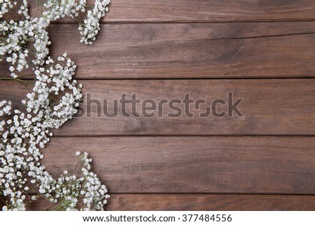 beautiful baby's breath on wooden background - stock photo