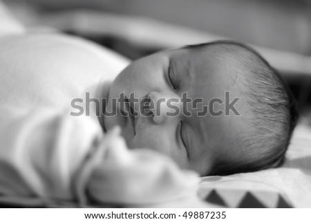 Beautiful baby sleeping, black and white - stock photo