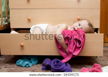 beautiful baby trying to dress