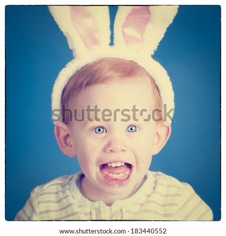 Beautiful baby wearing Easter bunny ears on head with Instagram effect filter