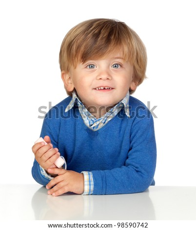 Beautiful baby with blue jersey eating a sweet isolated on white background - stock photo