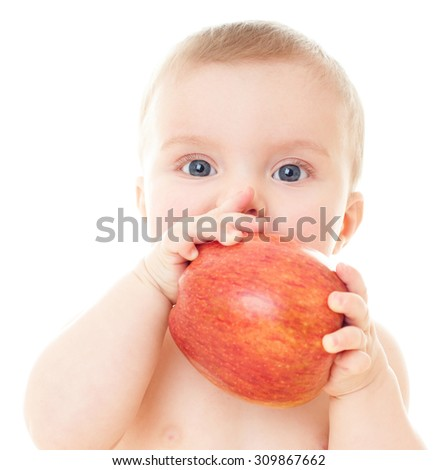 Beautiful baby with red apple. Baby eating healthy food isolated. - stock photo