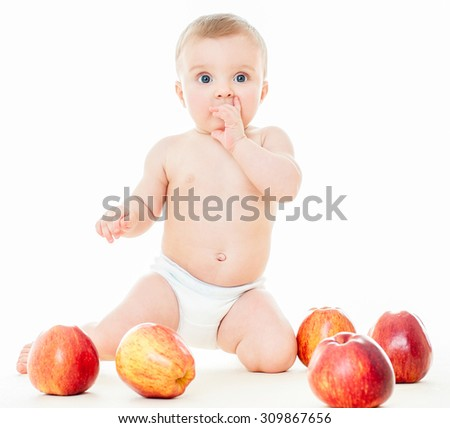 Beautiful baby with red apples. Baby eating healthy food isolated.