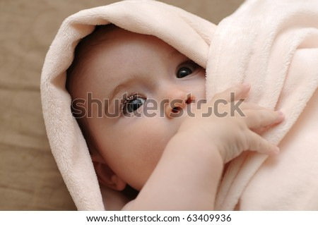 Beautiful baby wrapped in a pink blanket - stock photo