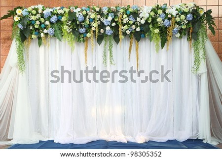 Beautiful backdrop flowers over white fabric ready for wedding ceremony. - stock photo