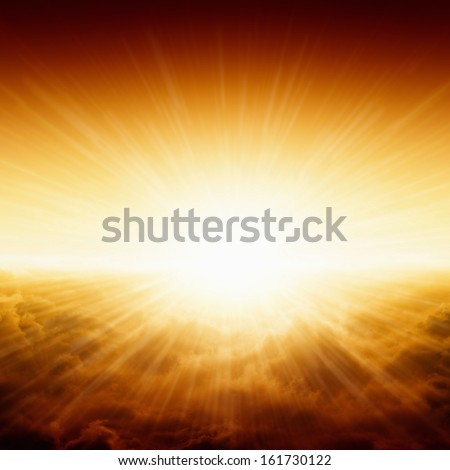 Beautiful background - bright red and yellow sunrise over dark clouds, glowing horizon - stock photo