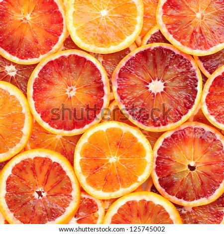 Beautiful background made of blood orange slices - stock photo