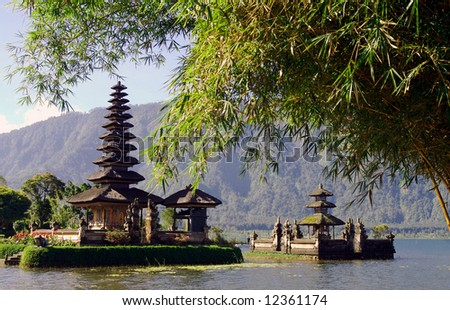 Beautiful Balinese temple on lake in extinct volcano crater - stock photo