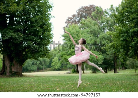 Beautiful ballerina is dancing - stock photo
