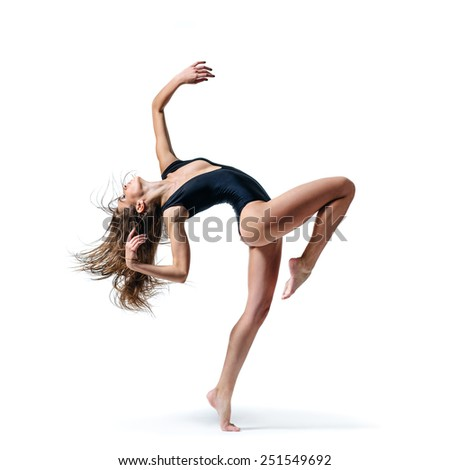 beautiful ballet dancer posing on a iwhite isolated background - stock photo