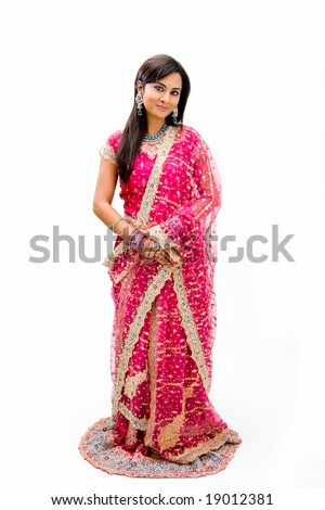 Beautiful Bangali bride in colorful dress standing, isolated