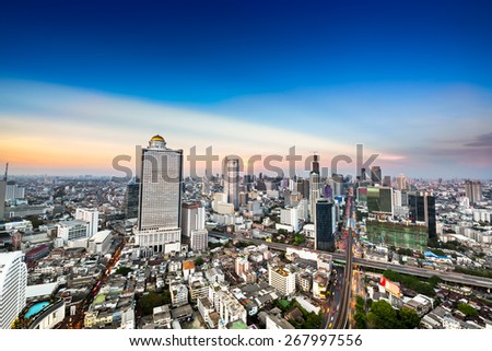 Beautiful Bangkok metropolis skyline with urban skyscraper on blue tone