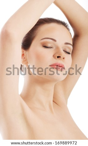 Beautiful bare woman with her hands up. Isolated on white. - stock photo