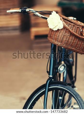 Beautiful basket on an old bike - stock photo
