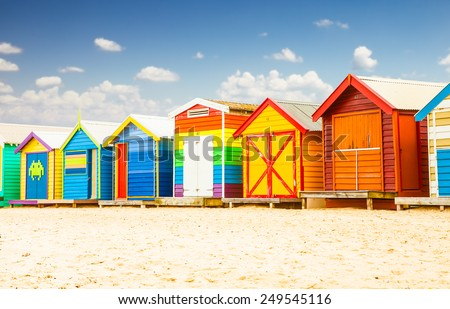 Beautiful Bathing houses on white sandy beach at Brighton in Melbourne, Australia. - stock photo