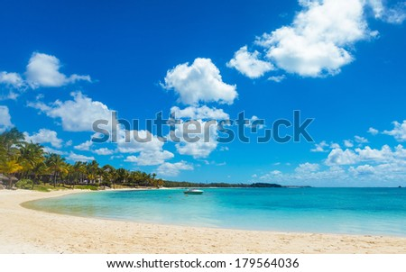 beautiful bay in mauritius island with speed boat in sunny summer day - stock photo