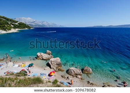 Beautiful Beach and Adriatic Sea with Transparent Blue Water near Split, Croatia - stock photo