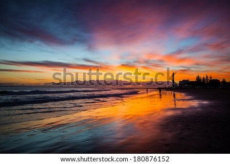 beautiful beach and lighthouse at sunset on gran canaria island - stock photo