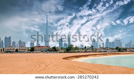 Beautiful beach and sea with Burj Khalifa - stock photo