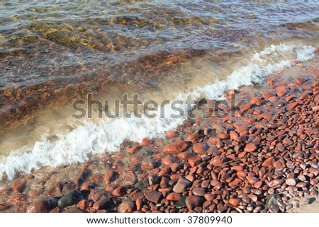 Beautiful beach and stones on Lake Superior - stock photo