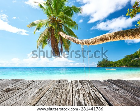 Beautiful beach at Seychelles and old wooden pier - stock photo