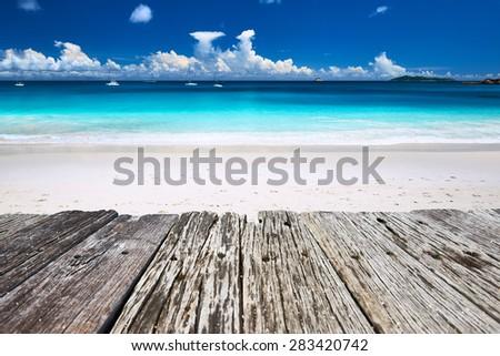 Beautiful beach at Seychelles and old wooden pier, Praslin, Anse Lazio - stock photo