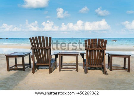 Beautiful beach chairs on tropical white sand beach - stock photo