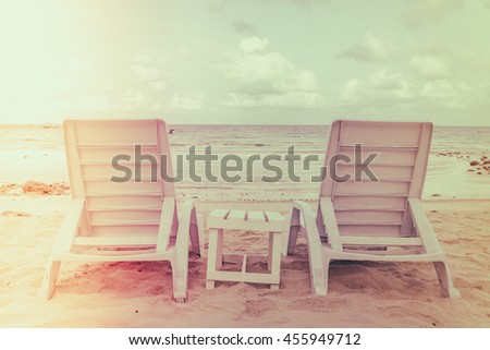 Beautiful beach chairs on tropical white sand beach - Filtered image processed vintage effect