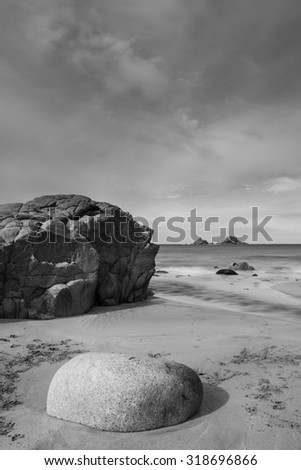 Beautiful beach landscape with pastel colors in morning light in black and white - stock photo