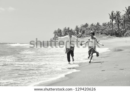 Beautiful beach marriage. the bride and groom against the blue ocean, shot on Bali island Indonesia