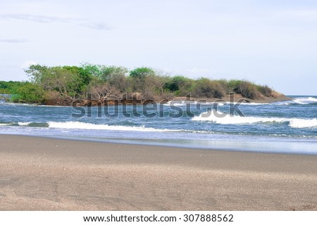 Beautiful beach on the Pacific ocean. This is Las Penitas - one of the closest beaches to the city of Leon, Nicaragua. - stock photo