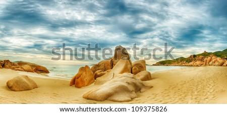 Beautiful beach panorama. Stones on the foreground - stock photo