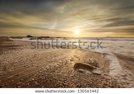 Beautiful beach photo, sea, dramatic clouds and stunning light - stock photo