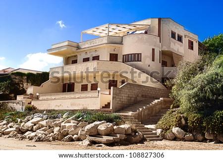 Beautiful Beach Property on the Sicilian Coast. - stock photo