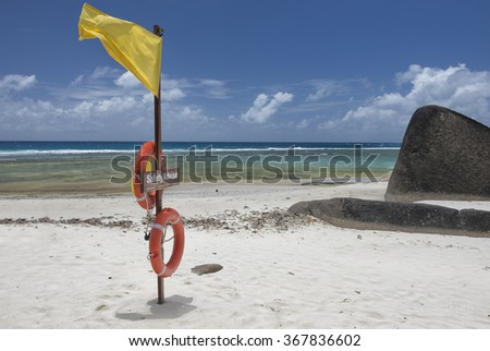 Beautiful beach scene in Seychelles  - stock photo