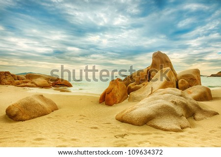 Beautiful beach. Stones on the foreground - stock photo