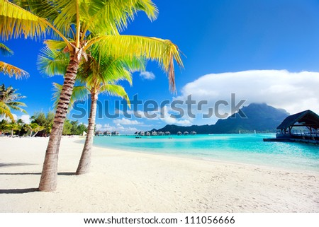 Beautiful beach with a view of Otemanu mountain on Bora Bora island - stock photo