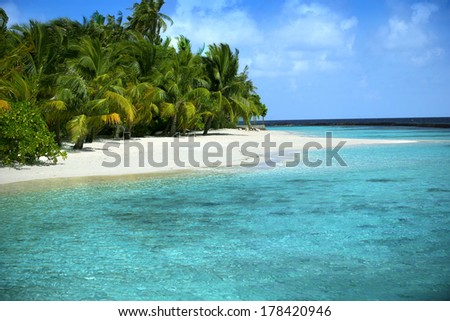 Beautiful Beach with blue sea & blue sky - stock photo