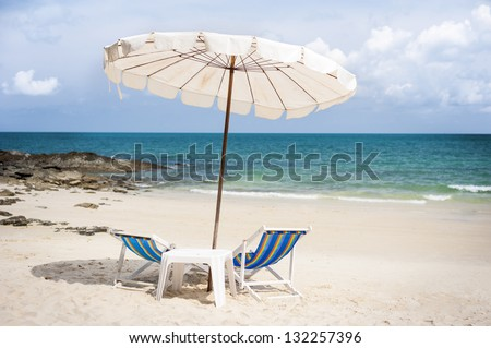 Beautiful beach with chairs and umbrella