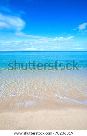 Beautiful beach with crystal clear blue waters of the Andaman sea against blue sky inThailand. - stock photo