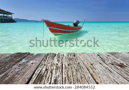 Beautiful beach with motor boat at Perhentian islands, Malaysia - stock photo