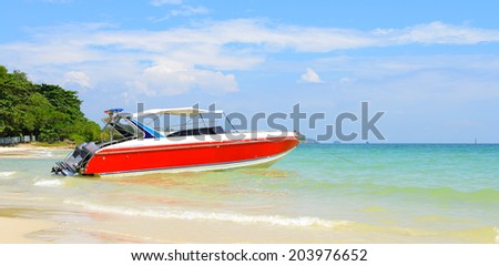 Beautiful beach with red motor boat at Samed island, Thailand - stock photo